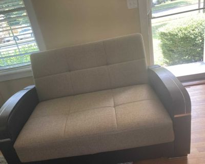 Beige Love Seat Futon. Great for office Space or a relaxing room