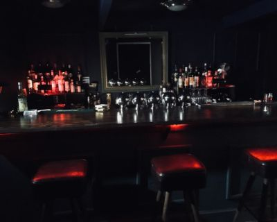 A bar/ private club set with tropical outdoor area, los angeles, CA