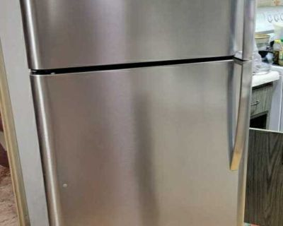 Stainless steel, top mount refrigerator
