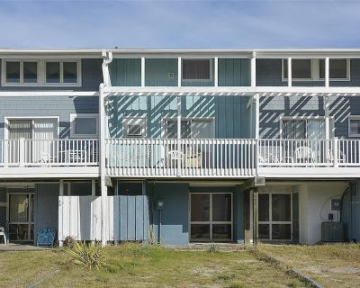 """FREE DAILY ACTIVITIES! Located approx one half block from the beach, this """"vintage"""" multi-level basic beach townhouse includes 4 bedrooms, 2.5 baths, 4 window air-conditioners in bedrooms - Tower Shores"""