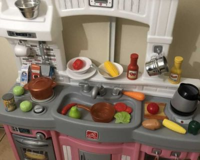 Modern play kitchen with play food