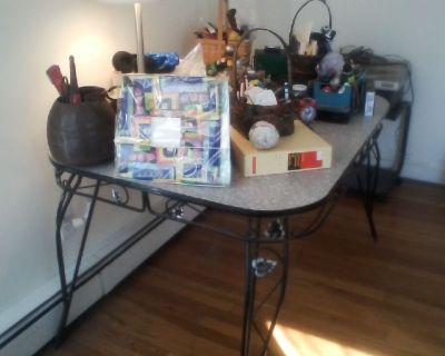 free vintage 50s kitchen table w/ w/ ornamented base & legs + recumbent tunturi exercise bike
