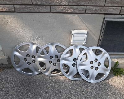 4 hubcaps from a Chevy Cavalier