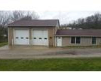 Commercial garage for rent. Located 7395 national Pike FOR RENT