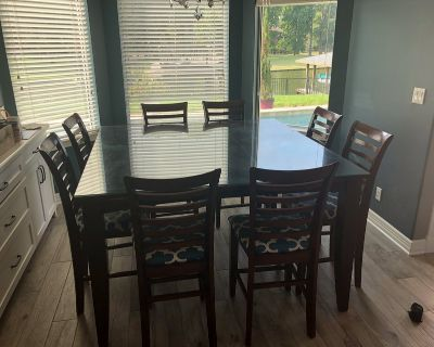Square tall kitchen table with eight chairs