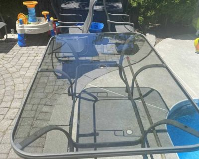 Patio table, four chairs and umbrella stand
