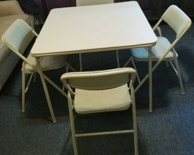 Folding table & 4 fabric padded chairs. Padded upholstery! Fold away design, quick storage & portability!