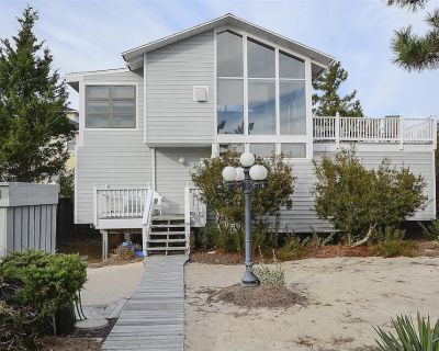 FREE ACTIVITIES INCLUDED!!! One house back from the ocean front this 4 bedroom, 2 bath beach house features an inverted floor plan - Bethany Beach