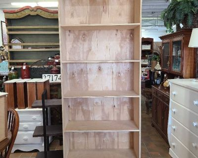 Tall solid wood bookcase $175