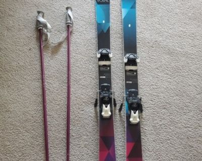 Skis with bindings and poles in great condition ($250), + gear