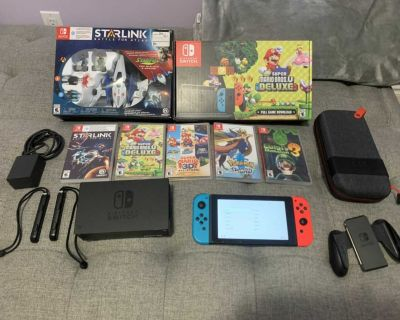 Nintendo switch Mario Bros. U Deluxe with 5 games and accessories!