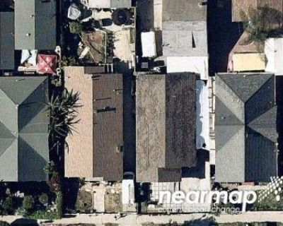 Preforeclosure Property in Los Angeles, CA 90037 - And 129 West 52nd Street