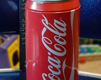 """Like new. Coca-Cola tin can Bank 7.5"""" x 3 3/4"""". Top comes off to access money. Ave online $16.00. Asking $10.00"""