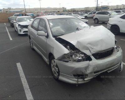 Salvage Silver 2003 Toyota Corolla