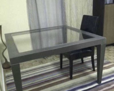 Very beautiful and functional Kitchen/dining room table . Solid Glass top with metal frame. Size 50 x 50 Very Good condition. Price :45$