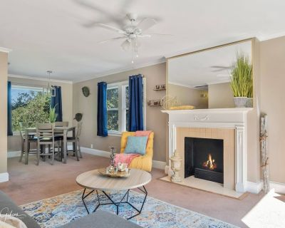 Large windows overlooking streets of historic South Highlands makes this cozy! - Caddo Heights-South Highlands
