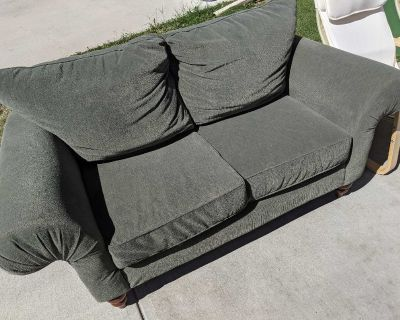 Super Comfy Olive Green Fabric Loveseat for pick up in Cooper's Crossing Airdrie