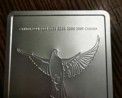 Millennium coin and stamp collectable tin