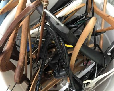 Lot of mostly wood and sturdy plastic hangers