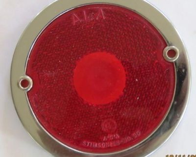 Check out these NOS tail light, includes a red lens and chrome plated bezel.These