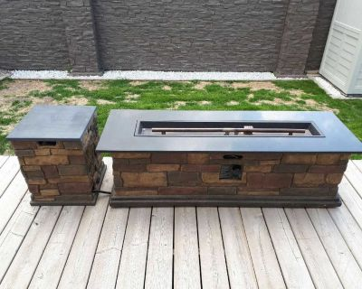 Fire pit, including propane tank, cover, and lava rocks