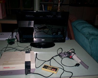 nintendo nes and hookups and controller and gun with mario& duckhunt game - TV IS NOT INCLUDED