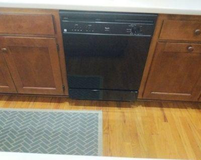 Used Whirlpool dishwasher. Works fine. Black.