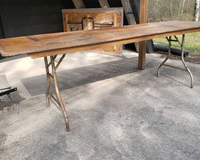 Two wood folding tables.