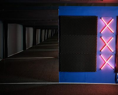 Soundproof studio for music videos, interviews and podcasts with dark blue walls, LED wall lights and mirrors - PRO III, Los Angeles, CA