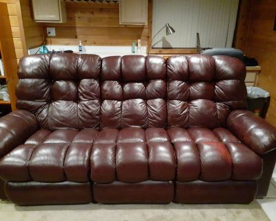 Lazy boy leather couch and two oversized rocking recliner chairs