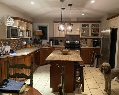 Wood kitchen cabinets 2 tone and island granit countertop