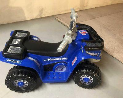 Power wheels four wheeler