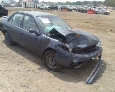Salvage Blue 1999 Toyota Corolla