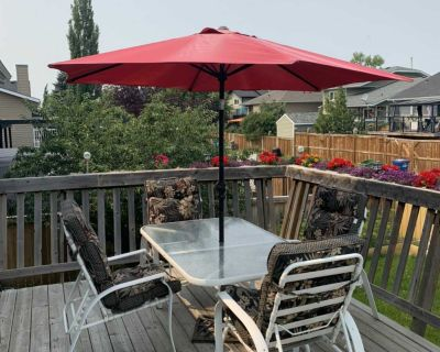 Patio table with umbrella and chairs $80