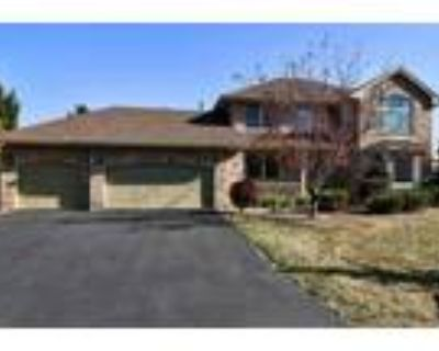 Gorgeous two story walk out on a large cul-de-sac lot in Evergreens!