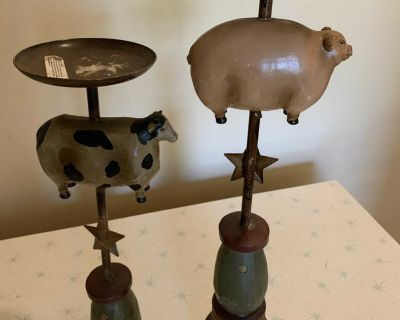 Candle holders with A flying cow and pig
