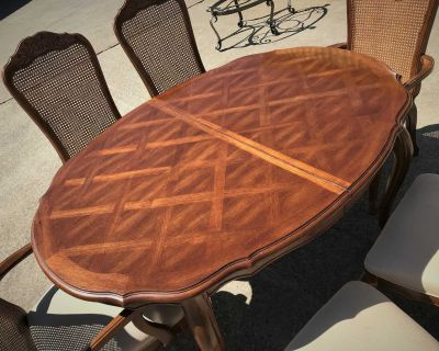 Dining Table, Chairs, Leaf, and Pads.