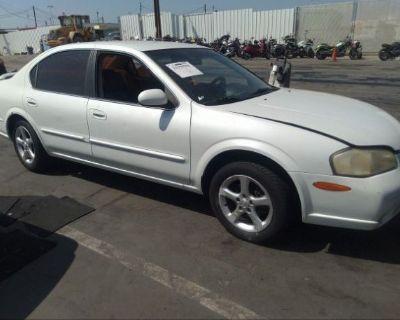 Salvage White 2000 Nissan Maxima