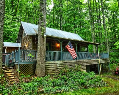 Nestled in the woods with a bold rushing creek running through the property. - Whittier