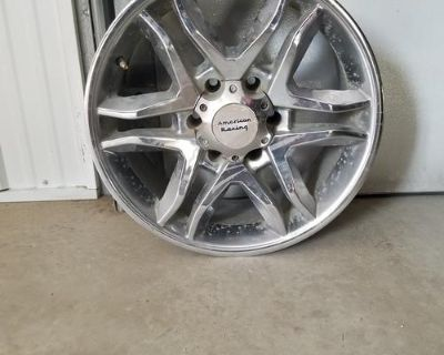 """18"""" American Racing rims. Came off of a 2014 half ton chevy pickup. 3 of the rims"""