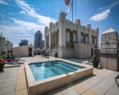 Spacious 2BR condo w/great roof + parking   by CozySuites - Downtown West