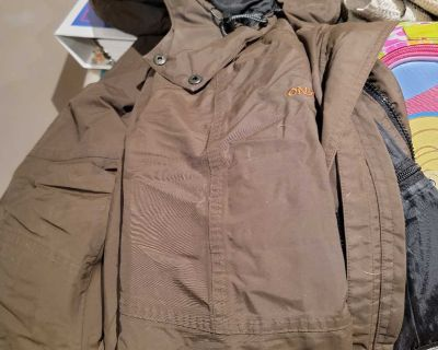 Free ladies med winter jacket and a bag of small shirts