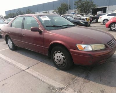 Salvage Red 1999 Toyota Camry