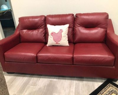 Bay red practically new loveseat and couch