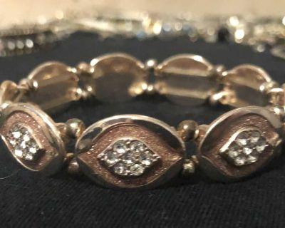 Rose gold and gold stretchy bracelet. EUC