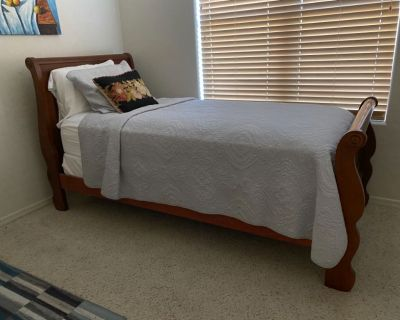Solid wood sleigh bed style bed frame with new twin size mattress