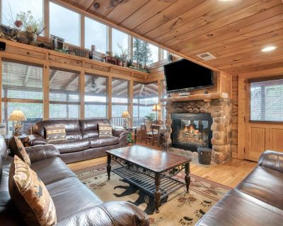 Impressive cabin with wrap-around decks, hot tub, fireplaces, and pool access - Pigeon Forge