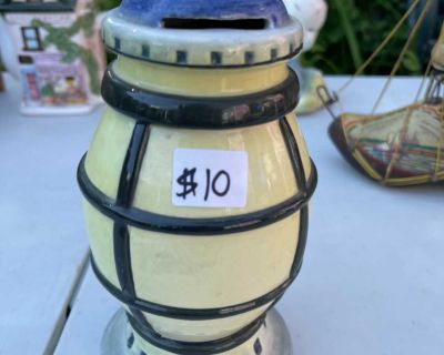 VERY NICE HAND PAINTED DECORATIVE LANTERN WITH HANDLE ITS A PIGGY BANK