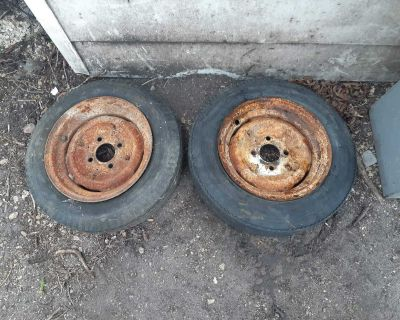 2 12 inch trailer rims, 4 bolt pattern. Tires are still in usable shape but tubes would need replaced