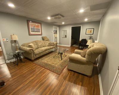 Beautiful Daylight Basement Furnished Apartment Near Everything! - Fayetteville